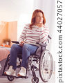 Serious woman sitting in the wheelchair 44027057