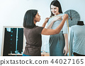 Pleased female person communicating with tailor 44027165