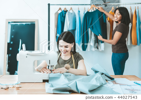 Positive delighted girls working in atelier 44027543