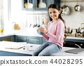 Charming joyful girl drinking tea in kitchen 44028295
