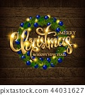 Christmas coniferous wreath on a wooden background 44031627