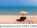 Landscape of a chair and beach umbrella. 44031908