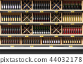 Various bottles of wine display on shelf 44032178