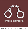 fresh metal handcuffs on a dark background 44032717