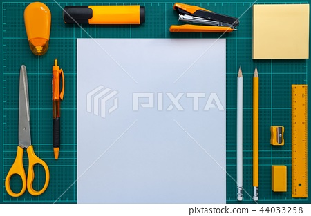 Stationery and paper on cutting mat 44033258