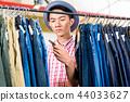 Man looking at price tag 44033627
