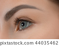 The close up eyes on face of young beautiful caucasian girl 44035462