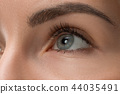 The close up eyes on face of young beautiful caucasian girl 44035491