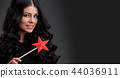 Woman with star shaped magic wand 44036911