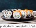 sushi rolls set served on wooden plate, copy space 44037244