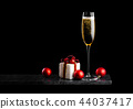 Elegant glass of yellow champagne with bubbles 44037417