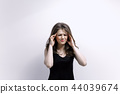 headache, female, portrait 44039674