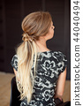 Unrecognizable rear view of woman hairstyle. Half-length back view of woman with slim waist and long 44040494