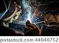 Welder working at the factory made metal 44040752