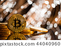 Bitcoin gold coin with defocused abstract background. Virtual cryptocurrency concept. 44040960