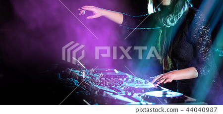 Dj mixes the track in the nightclub at a party 44040987