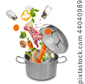 Stainless steel pot with flying ingredients. 44040989