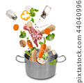 Stainless steel pot with flying ingredients. 44040996