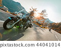 Motorcycle driver riding japanese high power cruiser in Alpine highway on famous Hochalpenstrasse, Austria. 44041014