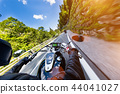 Motorcycle driver riding in Alpine highway, handlebars view, Austria, Europe. 44041027