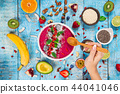 Smoothie bowl with fresh berries, nuts, seeds, fruit and vegetables. 44041046