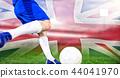Composite image of football player kicking ball 44041970