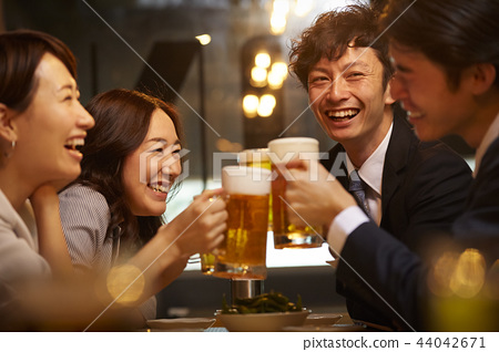 Working people drinking alcohol 44042671