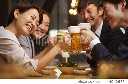 Working people drinking alcohol 44042675