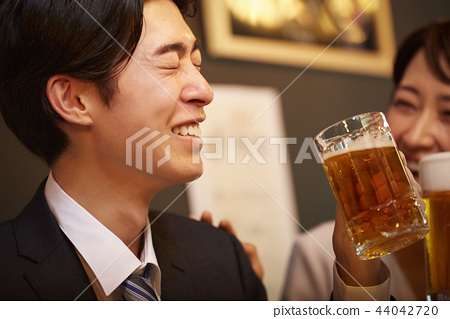 Working people drinking alcohol 44042720