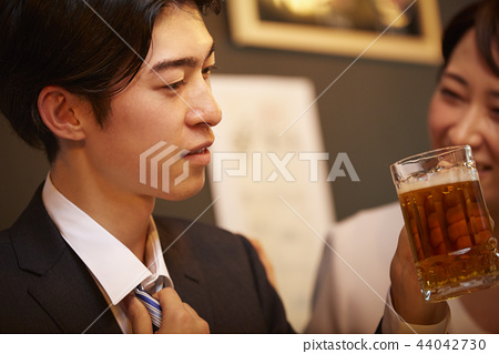 Working people drinking alcohol 44042730