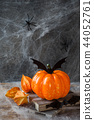 Pumpkin with bats and spiders  44052761