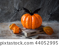Pumpkin with bats and spiders for Halloween,  44052995