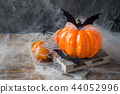 Pumpkin with bats and spiders for Halloween,  44052996