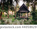 Thai pavilion in lush tropical garden coconut tree 44058629
