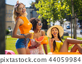 Positive young women meeting for a picnic 44059984