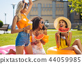Joyful happy beautiful women enjoying their picnic 44059985