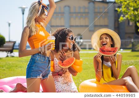 Joyful happy beautiful women enjoying their picnic 44059985