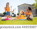 Delighted nice young women organizing a picnic 44059987