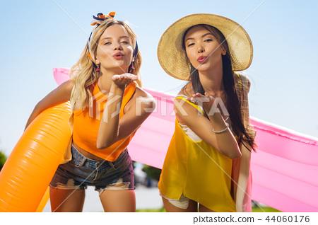 Joyful happy women sending you the air kiss 44060176