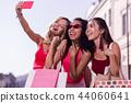 Joyful happy woman holding her new smartphone 44060641