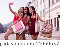 Nice happy women taking photos for social media 44060657