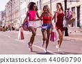 Delighted happy women enjoying their nice walk 44060790