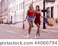 Positive young women walking down the street 44060794