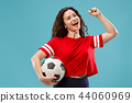 Fan sport woman player holding soccer ball isolated on blue background 44060969