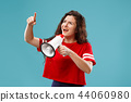 Woman making announcement with megaphone 44060980