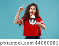 Woman making announcement with megaphone 44060981