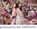 Beautiful asian women florists happy working in flower store with a lot of spring flowers 44062031