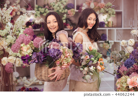 Beautiful asian women florists happy working in flower store with a lot of spring flowers 44062244