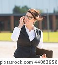Young business woman with tablet and phone 44063958