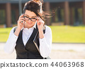 Young business woman with tablet and phone 44063968